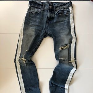 Stacked skinny destroyed jeans